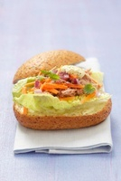 Tuna, carrots, red onions and mayonnaise on a bread roll