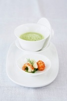 Pea and lettuce soup with semolina dumplings and crayfish