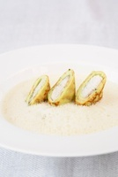 Riesling herb soup with pancake and eel rolls