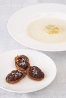 Onion soup with black pudding croutons