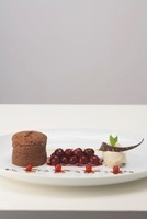 Chocolate pudding with spiced cherries and tonka bean ice cr