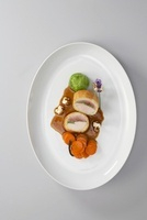 Quail and chicken breast in corn sponge with vegetables