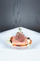 Saddle of lamb with a rhubarb and cucumber medley and a spic