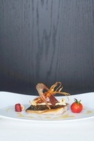 Mackerel fillet with roasted onions and braised tomatoes