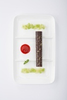 A chocolate roll with apple and kiwi compote