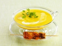 Carrot soup with a salmon kebab