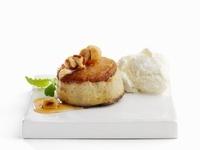 An apple dessert with cinnamon, roasted nuts and vanilla ice