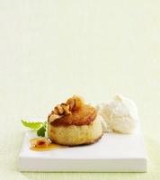 Apple dessert with nuts and vanilla ice cream (Sweden)