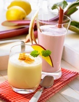 Orange juice and yogurt drink with cornflakes and a rhubarb