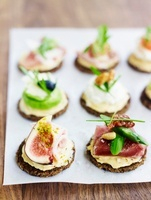 Canapes with mustard butter and various toppings