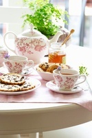 A table laid for tea with honey and biscuits