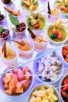 A buffet of fruit, cheese and cream desserts