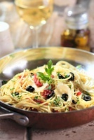 Linguine alla puttanesca with sardines and olives