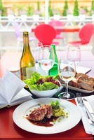 Pork fillet with pea puree, salad, bread and wine
