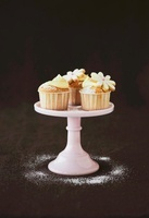 Cupcakes decorated with dough flowers and cream