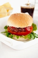 Hamburger with tomato and ketchup
