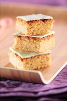 A stack of three slices of almond cake