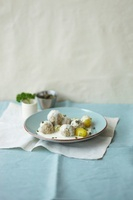 Meatballs in white sauce with capers