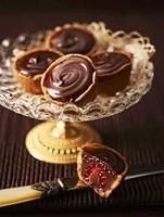 Raspberry cakes with chocolate cream on an elegant cake stan