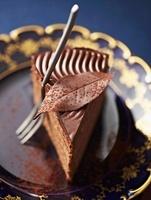 Truffle cake with a chocolate leaf
