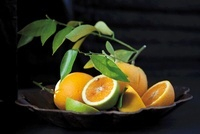 Various oranges in a bowl