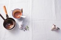 Dark gravy and saucepans