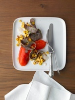 Bison Bratwurst-Tagliata on pine nut - corn kernel salad and