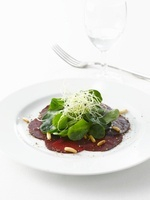 Red beet salad with pine nuts, spinach and basil