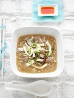 Asian hot and sour soup with pork and mushrooms