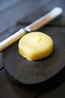 A pat of butter with a knife