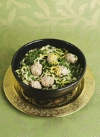 Kale soup with meatballs and lemon zest