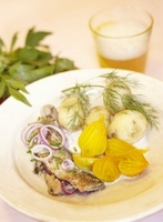 Cooked herring and mackerel with yellow beets, potatoes and