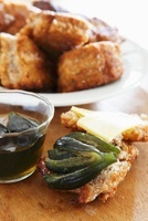 Vetkoek (fried tea cakes, South Africa) with fig preserves