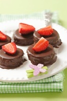 Petit fours with chocolate and strawberries