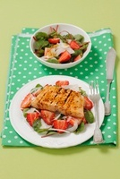 Red beet salad with strawberries and grilled salmon