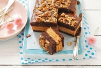 Chocolate biscuit cake with crackers, caramel and nuts