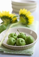 A bowl of green apples