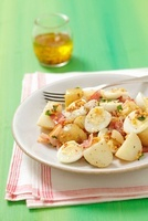 Potato salad with quail's eggs, bacon and a mustard dressing