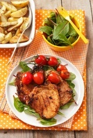 Grilled pork chop with cherry tomatoes