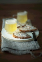 Bread spread with lard and crackling with shandy
