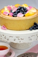 Cheesecake with fresh blueberries and rose petals