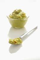 Guacamole in a bowl and on a spoon