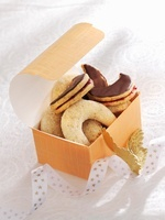 Vanillekipferl (cresent-shaped vanilla biscuits) and almond
