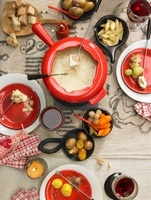 Swiss cheese fondue with potatoes, bread and vegetables (see