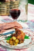 Confit de canard with roast potatoes and green beans (France