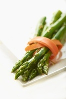 Slice of Carrot Wrapped Around Asparagus Spears