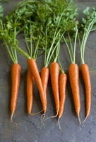 Whole Carrots on a Stone Surface