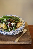 A mixed leaf salad with fried artichokes, asparagus, goat's