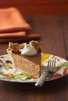Slice of Pumpkin Pie with a Dollop of Whipped Cream; On a Pl