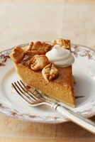 Slice of Pumpkin Pie with Pastry Leaves and Whipped Cream; O